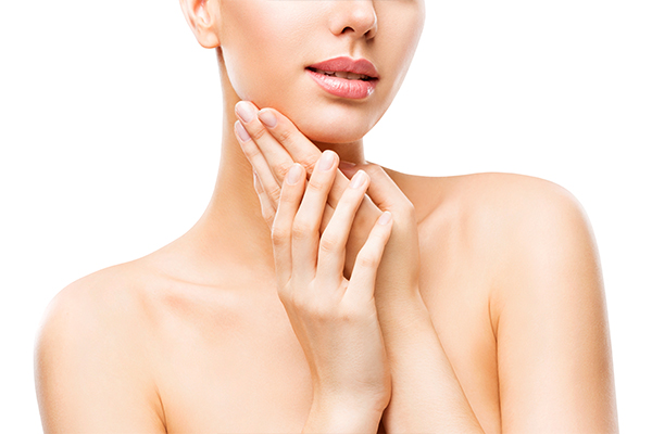 woman's face and hands - natural rosacea treatment