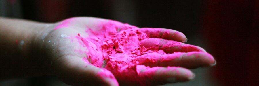 Red paint or chalk in woman's hand - hand eczema