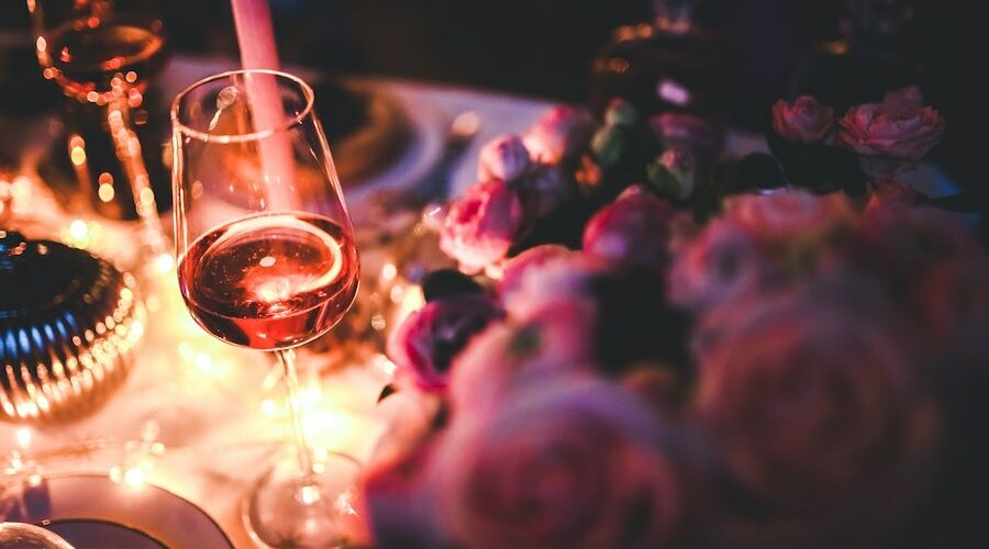 Candlelight table with wine glass - alcoholic beverages and skin
