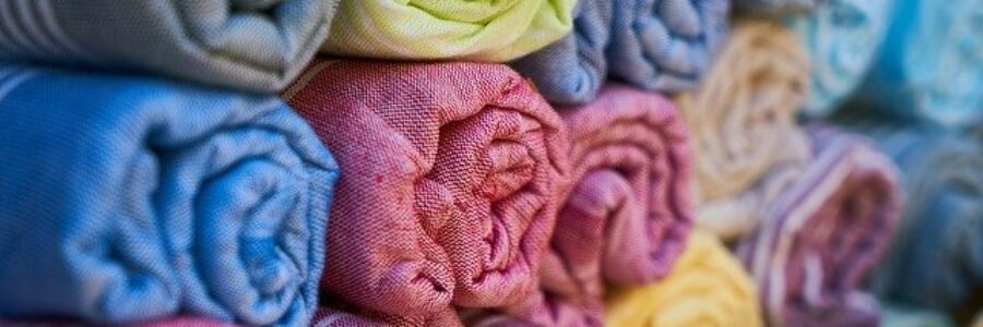 Colorful rolls of fabric - fabrics for skin conditions
